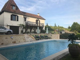 Large private fenced pool with lounging and eating area.
