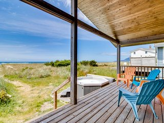 Dog-friendly waterfront beach cottage w/ private hot tub! Walk to the beach!