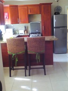 Well equipped Kitchen with granite counter tops, lots of cupboard space and breakfast bar.