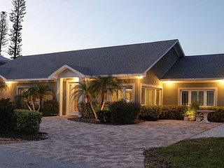 LUXURIOUS GROUND LEVEL HOME WITH HEATED POOL & SPA, JUST STEPS TO THE BEACH!!