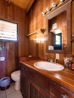 Upstairs bathroom with walk in shower.