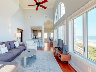 NEW LISTING! Sleek beachfront condo w/stunning views-walk to shopping & dining