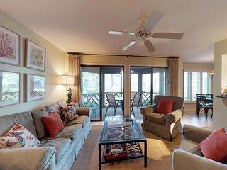 Spacious, modern home with lagoon views near golf, tennis, and beach