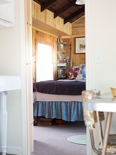 This is a view of the bedroom from inside the kitchenette.