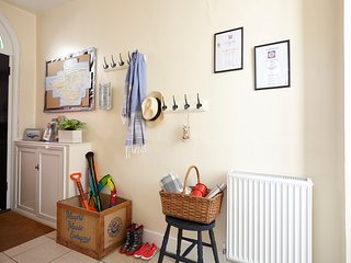 Front door opens to spacious hallway for unloading buckets & spades or leaving the wellies to dry!