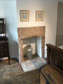 Original gritstone fireplaces in both bedrooms