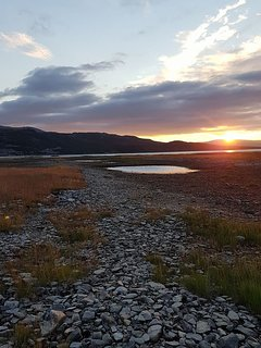 Down-river view towards the fjord and midnight sun.