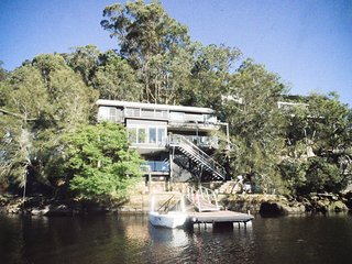 The 4 bedroom, 3 bathroom property is set out over 3 levels plus waterfront garden and private jetty