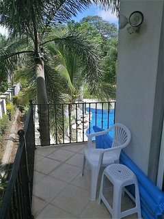 Bedroom Balcony w/ View Of Pool