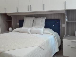 La camera Arancia è una splendida camera  di color crema  con un  stile moderno ed essenziale