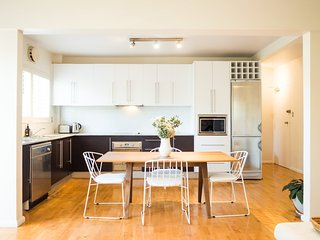 Generous open plan dining area with open plan kitchen