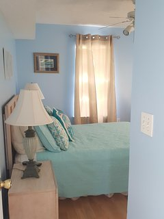 The downstairs master bedroom has 1 of 2 queen beds.