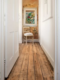 timber floors and distressed original plaster
