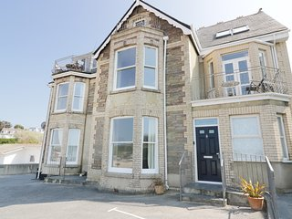 SEASHORE HOUSE, open-plan, views over Porth beach, superb location, near Newquay