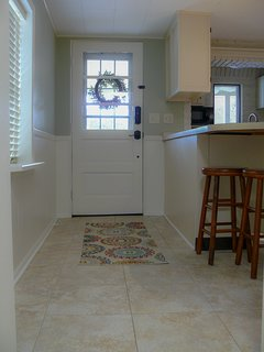 Front door leads into full size, fully stocked kitchen.