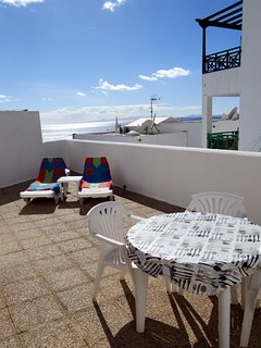 Extensive private sun terrace with loungers and views to Fuerteventura