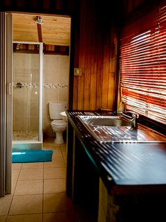 Kitchenette with Bathroom in Background