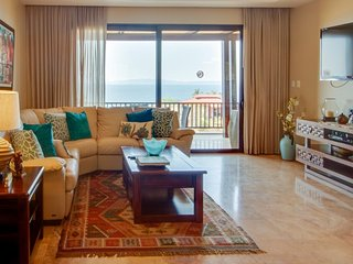 Dog-friendly condo with shared pool, ocean views, and easy access to beach
