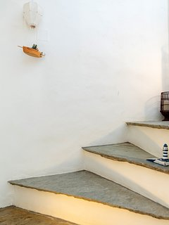 Inner staircase leading to the ground floor where the bedrooms are located