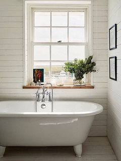 T&G clad bathroom with sea view