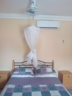 Bedroom, aircon, and ceiling fan