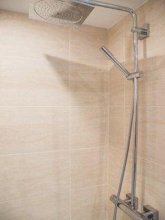 Ensuite bathroom: WC, basin, walk in shower