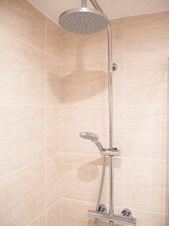 Bathroom 2: WC, basin, full size whirlpool bath with shower fittings