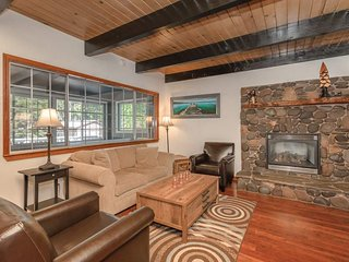 The gas fireplace, surrounded by river rock, make this living room the ideal spot to relax.