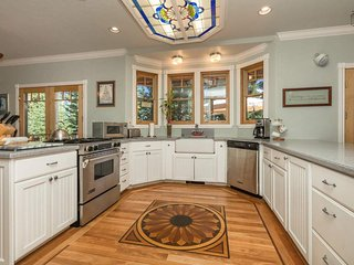 The well-outfitted kitchen has custom wood inlay in the floor and a marble cutting board and rolling pin.