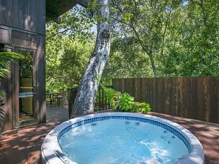 Commune with nature in the private outdoor hot tub.