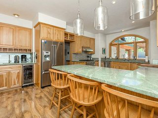 Large Tahoe Donner home with large yard, private hot tub, mountain views