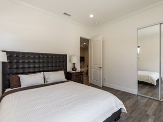 The second bedroom includes a California king sized bed and has its own wardrobe.