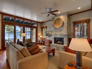 Enjoy warm family conversation in in the well appointed living room complete with gas fireplace and flatscreen TV.