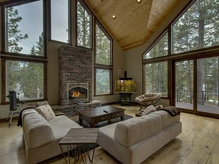 Spacious living room including telescope & glass doors opening to the deck