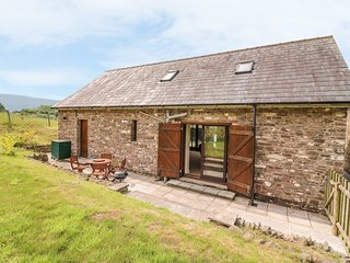 THE BARN, enclosed garden, farmyard, hillside views, near Abergavenny