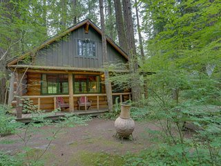 Discover peace and tranquility at this riverfront cabin among the trees.
