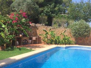 A charming exclusive apartment with private pool and garden in La Palmera villa
