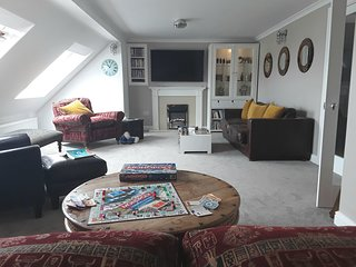 Relax in the 30ft upstairs lounge with front seaview,  lots of comfy seating and 55 inch TV DVD