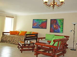 Caribbean style furnished condo at the beach