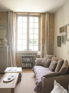 The large windows let in lots of natural light