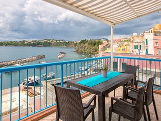 Cozy split-level apartment overviewing Marina Corricella Bay
