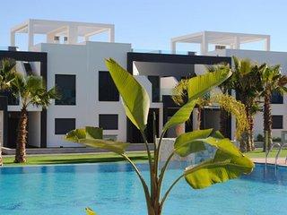 Appartement OasisBeach 4 en rez de chauss vue Jardin et Piscine