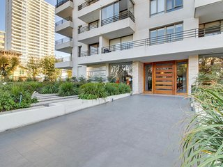Modern condo with cityscape views & community gym near beach.
