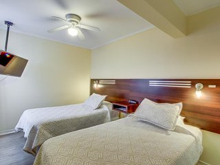 Cozy room with a central location, on-site dining, meeting rooms, & more!