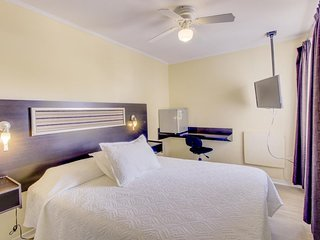 Cozy, stylish suite w/ on-site dining, shared meeting rooms, & central location!
