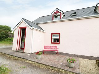 FUSCIA COTTAGE, solid fuel stove, en-suite facilities, open plan living area, ne