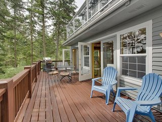 Dog-friendly, sound-view home features spacious deck, peaceful surroundings