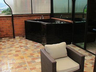 Lower Penthouse BALCONY WITH HOT TUB ROOF SLIDES CLOSED WHEN RAINS IN MIDDLE AC