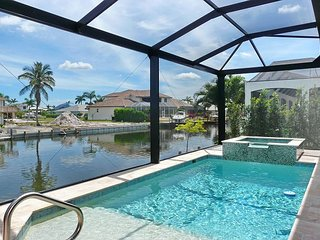 Picturesque waterfront home w/ heated pool, hot tub & outdoor kitchen