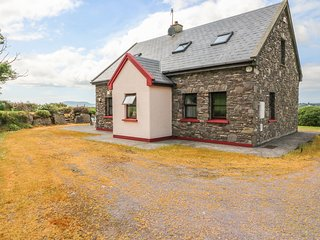 STONE COTTAGE, Ring of Kerry location, solid fuel stove, en-suite facilities